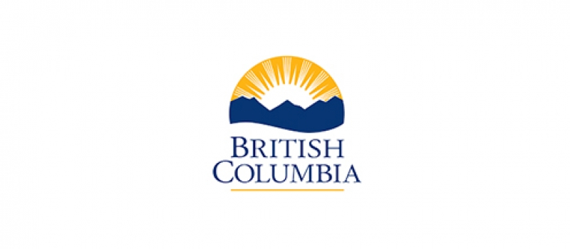 Logo for the government of British Columbia which includes a blue mountain range, a white sunset, and a yellow sky.